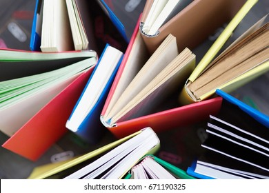 Old and used hardback books or text books seen from above. Books and reading are essential for self improvement, gaining knowledge Learning concept.