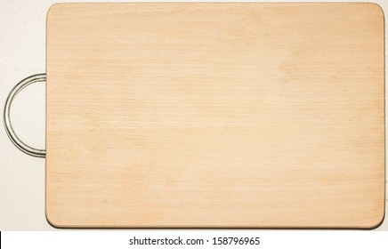 Old used kitchen wooden cutting board with scratch marks