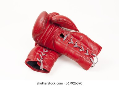 old used red leather boxing gloves putting hands together
