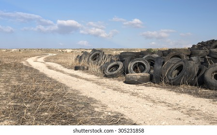 Old  used rubber tires  piled  in a recycling yard waiting to be  shredded and  re manufactured in to usable  products