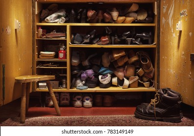 Old used shoes in old closet, lifestyle details.