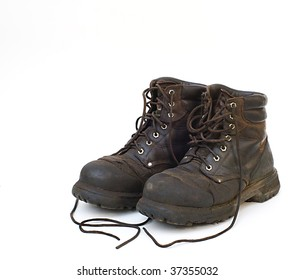 Old used work boots on white background
