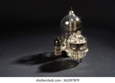 old vacuum tube on black background
