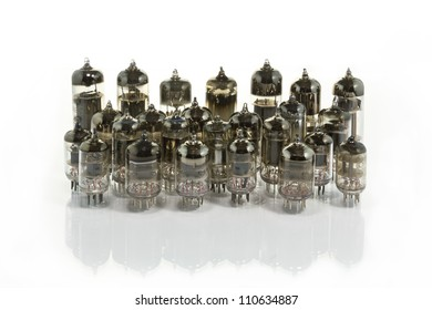 The old vacuum tubes on a white background.