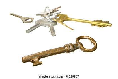 Old and various keys isolated on white