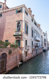Old Venetian Building by Canal with Brick Wall at Water Level
