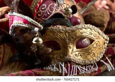 Old Venetian carnival masks with feathers. Selective focus.