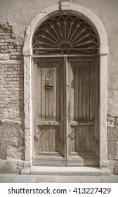 The old The Venetian door, of which can be seen  level of floods. Old style. Sepia