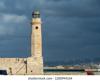 Old (Venetian) harbor with lighthouse in Rethymno, Crete, Greece