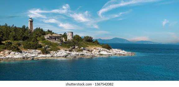 Old Venetian lighthouse in the Fiskardo port. Wonderful Sunny seascape of Ionian Sea, Kefalonia island. Greece