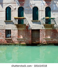 Old venetian rustic house standing in water, Italy