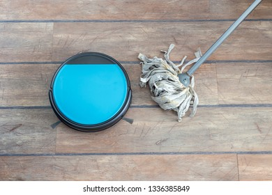 Old versus new and technology evolution concepts. Robot vacuum cleaner and mop side by side.