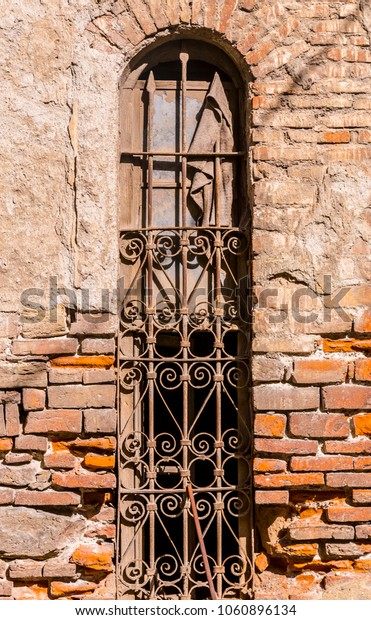 Old vertical window on red brick wall texture background, architectural detail, urban cozy background with stains