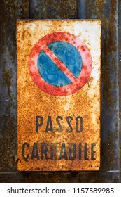 Old and very rusty No Parking sign with italian words on it cause it is italian sign in italian city, logical!