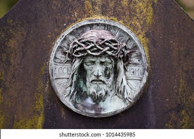 An old and very weathered tomb sculpture of Jesus Christ