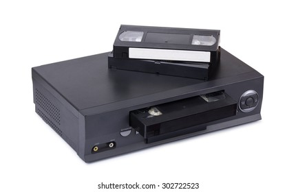 Old VHS video recorder with cassettes isolated on white background