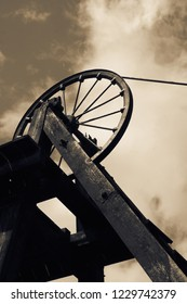 Old Victorian coal shaft tower and wheel pulley with colour toning