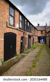 An old Victorian cobbled back-yard street in Tring, Hertfordshire, England.
