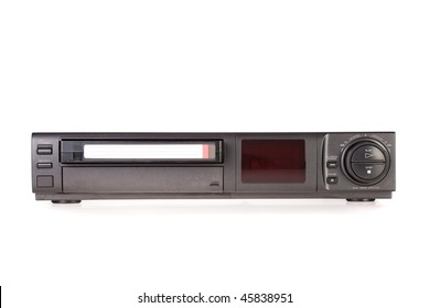 Old Video Cassette Recorder ejecting tape isolated on white background