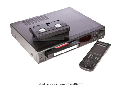 Old Video Cassette Recorder and tapes isolated on white background