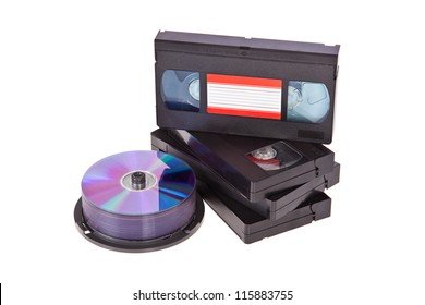Old Video Cassette tapes with a DVD disc isolated on white background