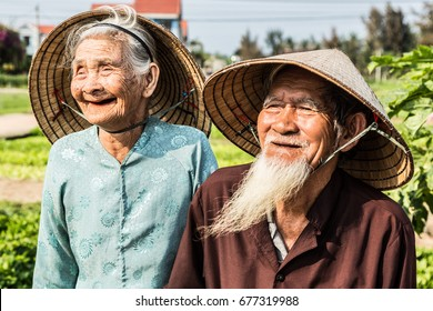 Old Vietnamese farmer couple in color - Tra Que - 13 March 2017