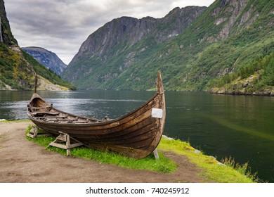 Old viking boat replica in a norwegian landscape near Flam, Norway.