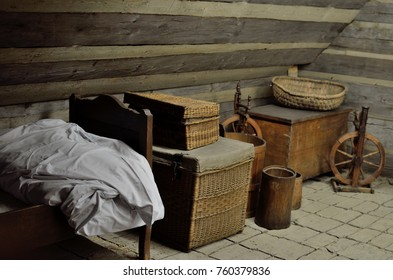 Old village fairytale attic with spinning wheels, old bed and chests