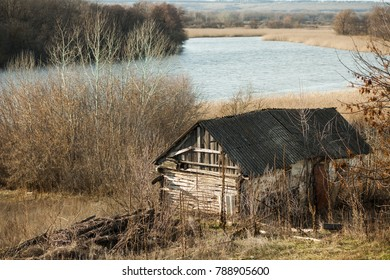 Old village house in the background of the river.
