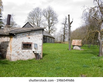 Old village house with outbuildings.