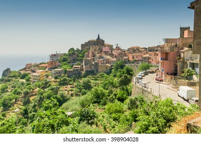 Old village on rocky hills over the sea in Sicily, Italy