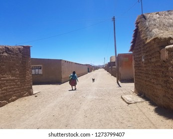 Old village in South America constructed with clay bricks and mud. Native walking through the narrow roads. Clay homes