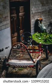 Old village wooden car and village street alley
