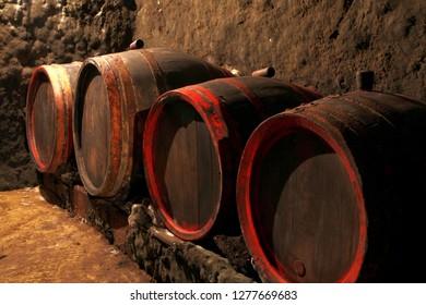 old vine barrels in a vinecellar