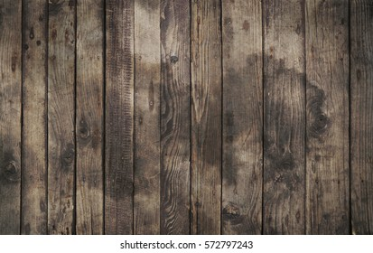 Old vintage aged grunge dark brown and gray wooden floor planks texture background with stains and nails