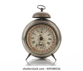 Old vintage alarm clock isolated on white