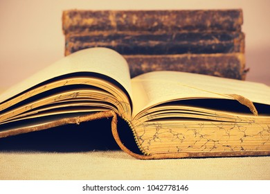 old vintage antique books with textured pape. background. Vintage style. Reading Science and Literature