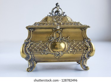 An old vintage antique gold casket