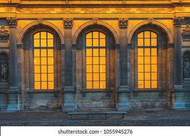 Old vintage arched windows glowing from inside.