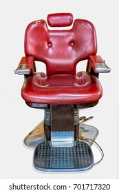 old Vintage barber chair (barber shop) isolated on white background.