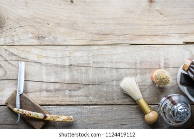 Old vintage barbershop tools on wooden table - barbershop background with copy-space
