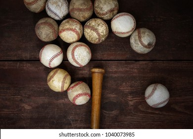 Old Vintage Baseballs on a wooden background