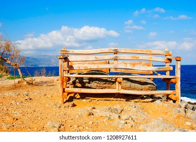 old vintage bench near the rocky coast of Sissi on Crete in Greece