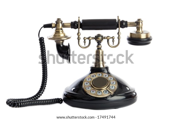 Old vintage black phone a over white background.