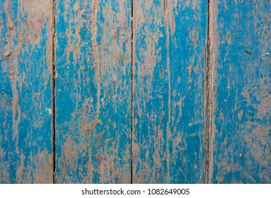 Old vintage blue and beige painted wooden planks. Rustic background texture.