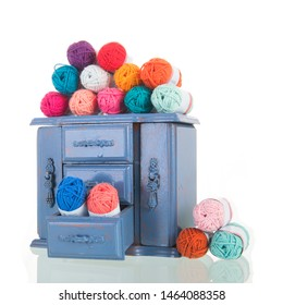old vintage blue cabinet with knitting wool isolated over white background