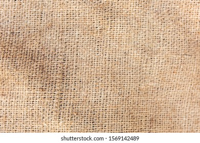 Old vintage blurred linen cloth textile. Burlap rustic tumbled texture background.