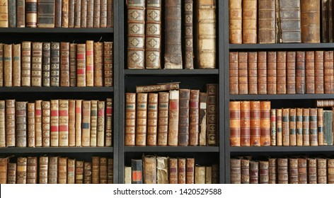 old, vintage books on wooden shelf