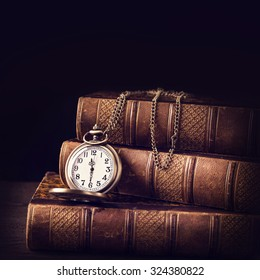 Old vintage books and a watch