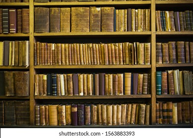 Old vintage books. Wisdom and knowledge. Literature on shelf in library. Classic literature. Science and education. Aged books. Retro background. Ancient encyclopedia. Knowledge from encyclopedia